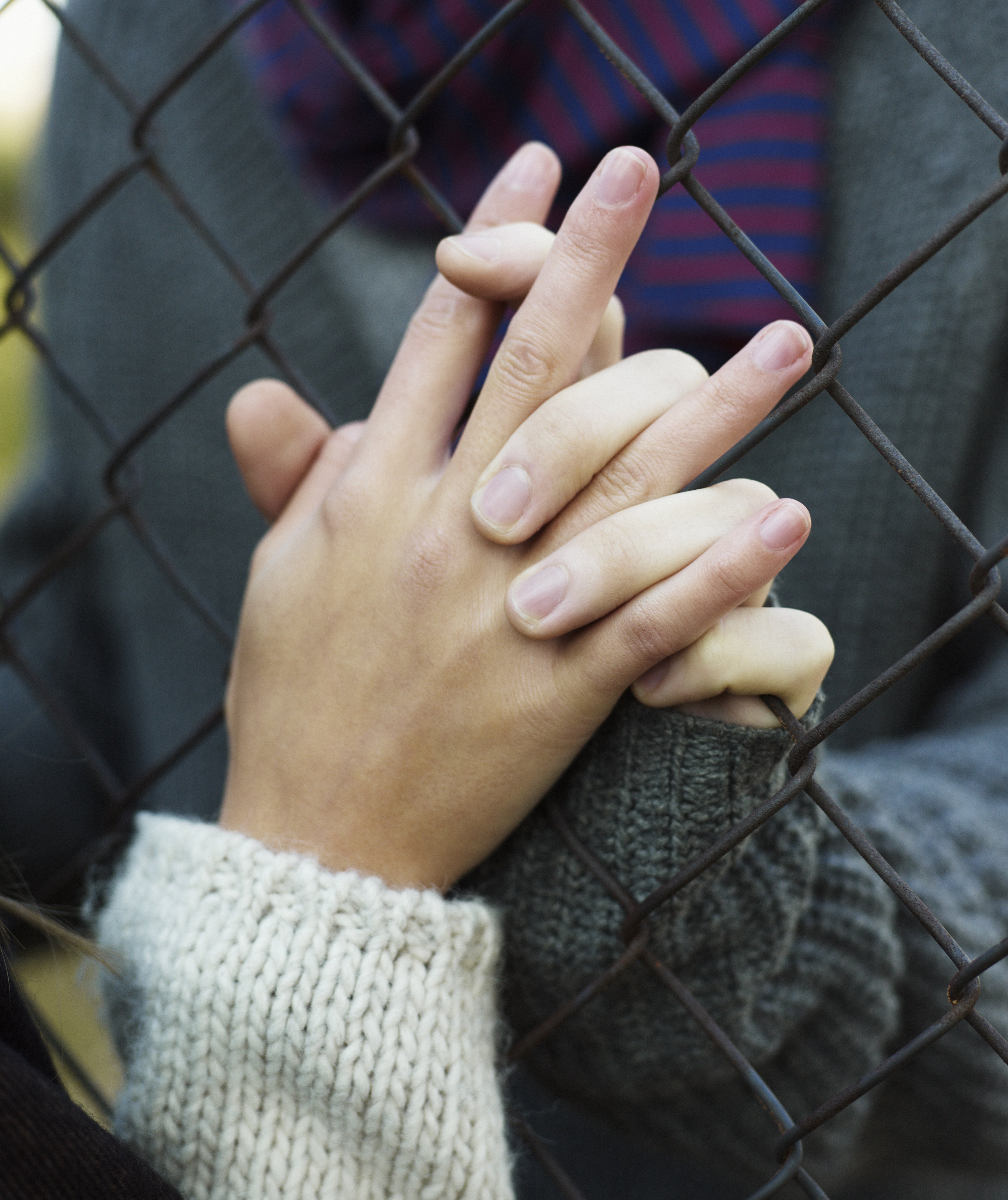 holding-hands-fence