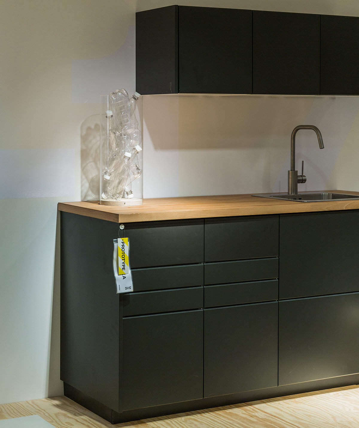 ikea is turning recycled bottles into kitchen cabinets real simple. Black Bedroom Furniture Sets. Home Design Ideas