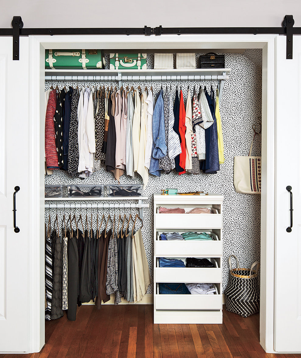 tips from professional organizers- groups of clothing hung together.